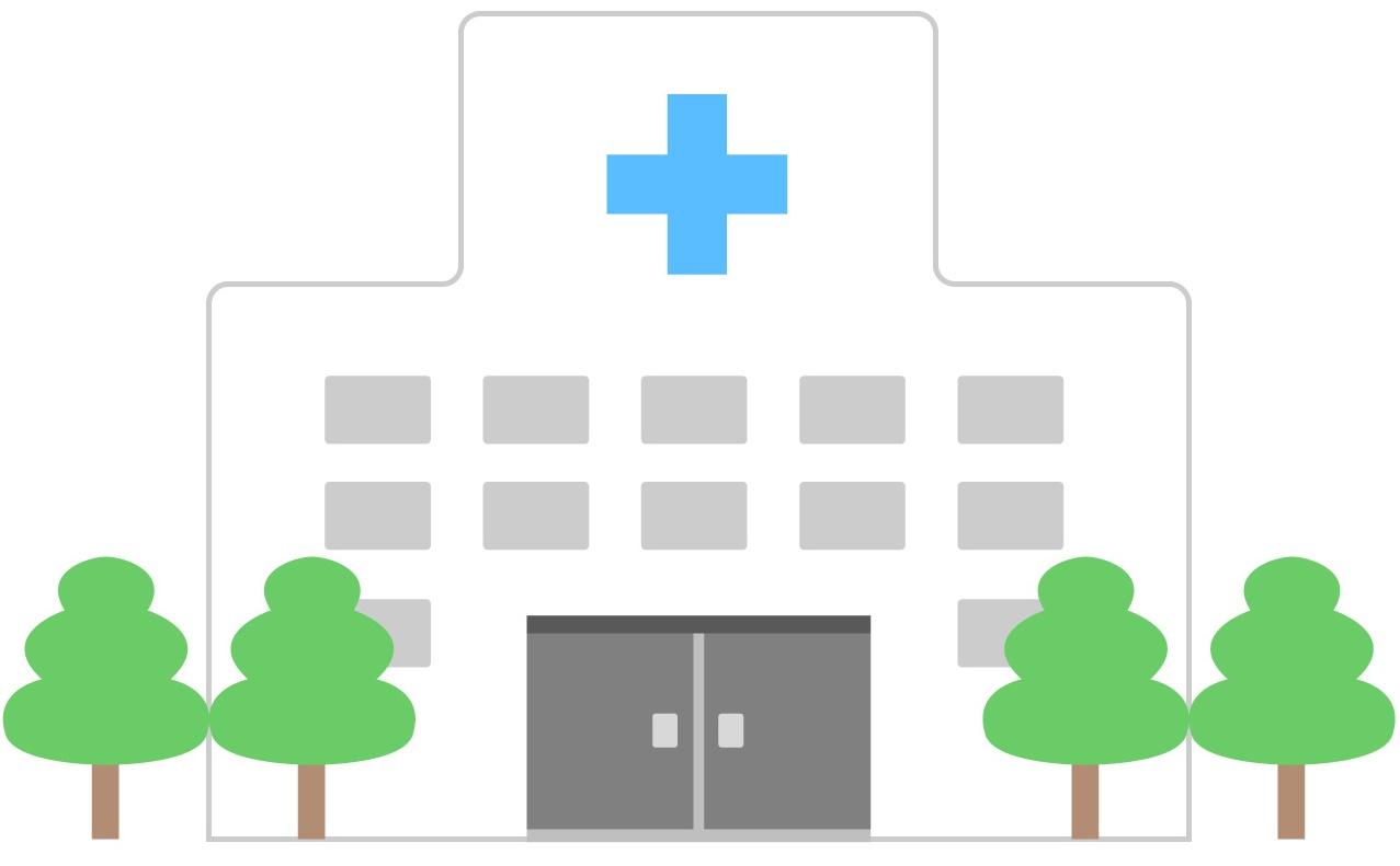 白い病院と緑色の木