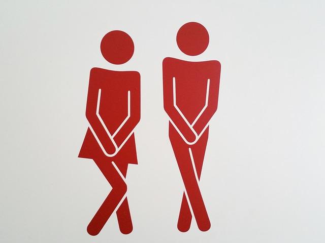 股間を両手で隠す赤い男女のイラスト