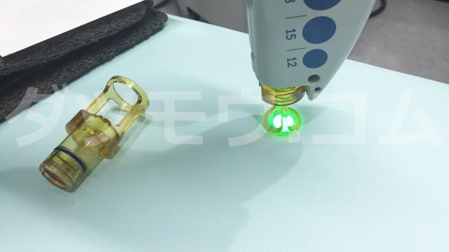 緑色のレーザー光